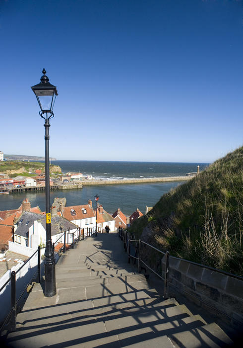View over the harbour from the 199 steps that lead up from Whitby town to the St Marys Church on Tate Hill
