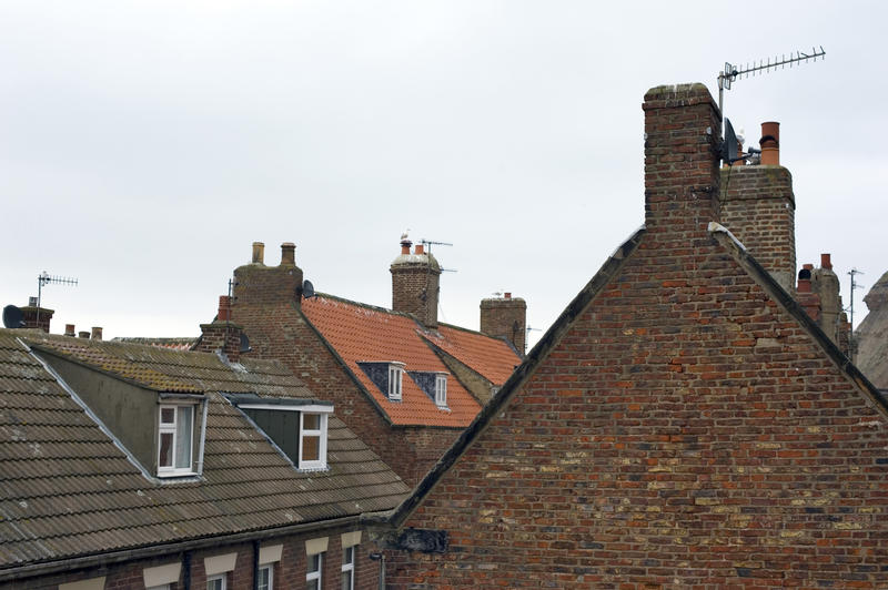Whitby cottage roofs with traditional English roofing tiles and dormer windows