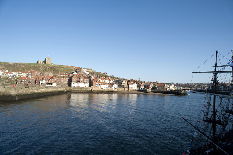 View across the water of the River Esk and harbour towards Tate Hill and St Marys Church in Whitby on the Yorkshire coast