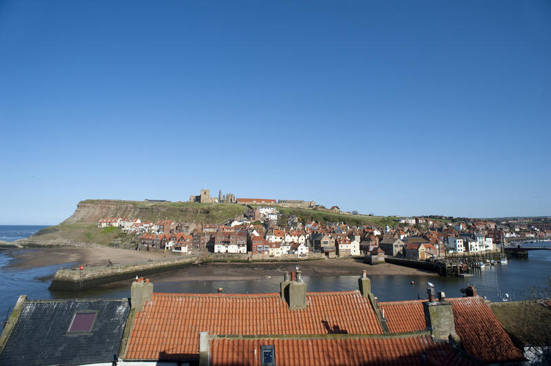 View of Tate Hill and St Marys Church above the town of Whitby which was used as the setting for Bram Stokers novel on Dracula