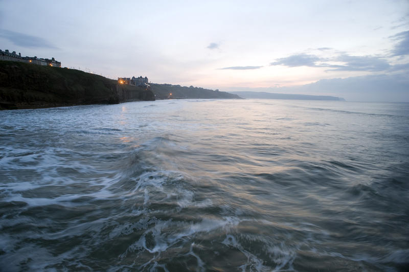 View of the village of Sandsend from the sea at dusk