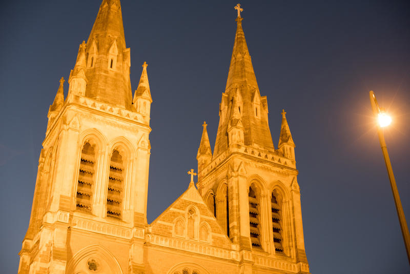 Illuminated spires of St Peters Cathedral, Adelaide, Australia at night in a close up low angle view