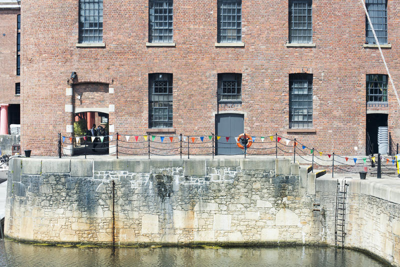 Low tide at Liverpool Albert Dock with railing, stairs and ladder in the United Kingdom