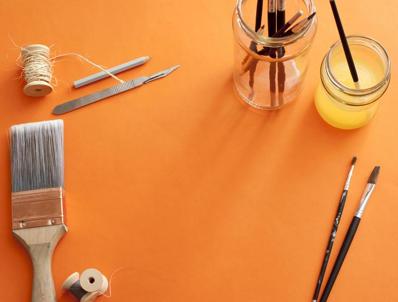 12140   Orange background bordered with art supplies