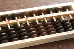 12724   Close up on abacus with brown and black counters