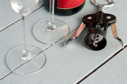 17141   Bottle opener with wineglasses and bottle of wine