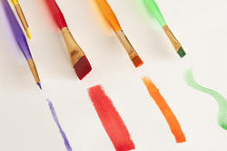 12144   Four different paintbrushes and paintstrokes
