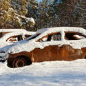 13170   burnt out cars covered in snow