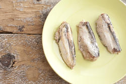 12353   canned sardines on green plate