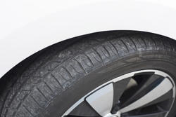 16349   Car tyre tread on a parked car