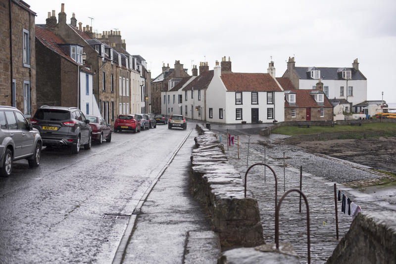 Wet Streets with Traditional White Houses and Parked Cars on Overcast Day, Cellardyke, Fife, Scotland