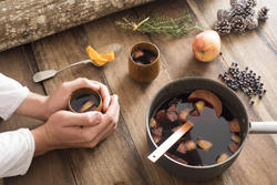 17180   Person warming their hands on mulled red wine