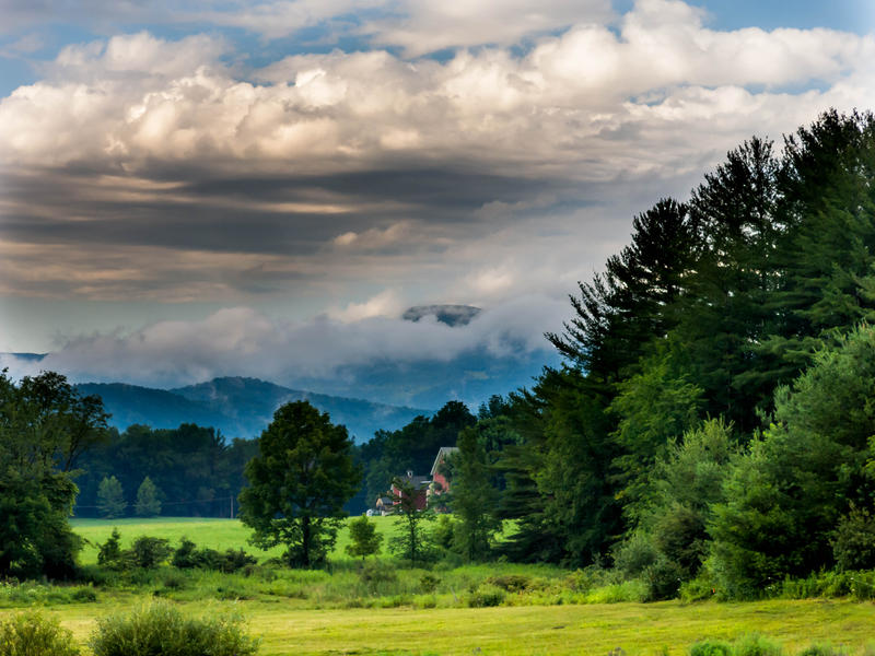 <p>Storm clouds and fog in rural Vermont valley.</p>