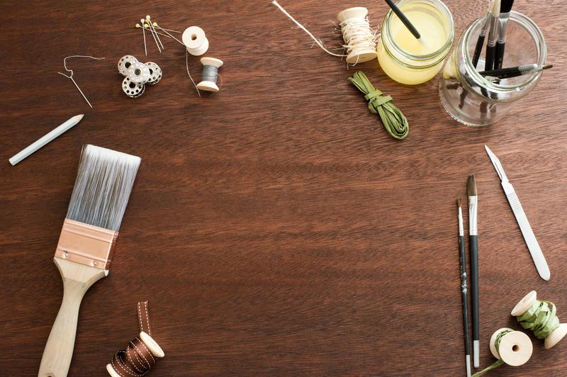 12163   Random art supplies around wooden table