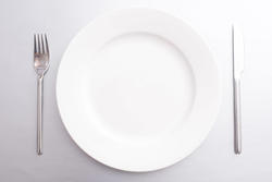17143   Clean empty white dinner plate with cutlery