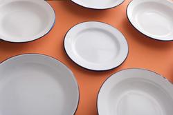 17154   Plain white enamel plates on orange