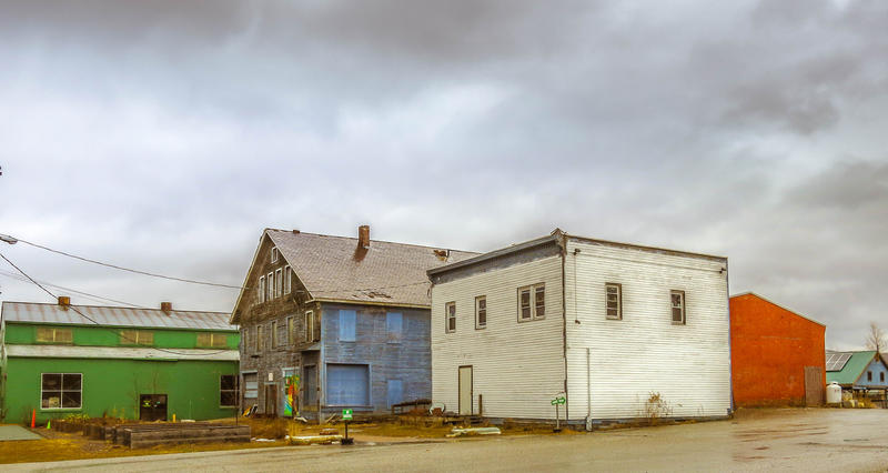 <p>The old farmers market Rutland Vermont with different color buildings.</p>