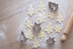 13150   Overhead view of unbaked tree shaped cookies
