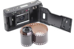 12166   Single roll of film next to compact camera