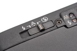 12170   Close up on flash mode switch on camera