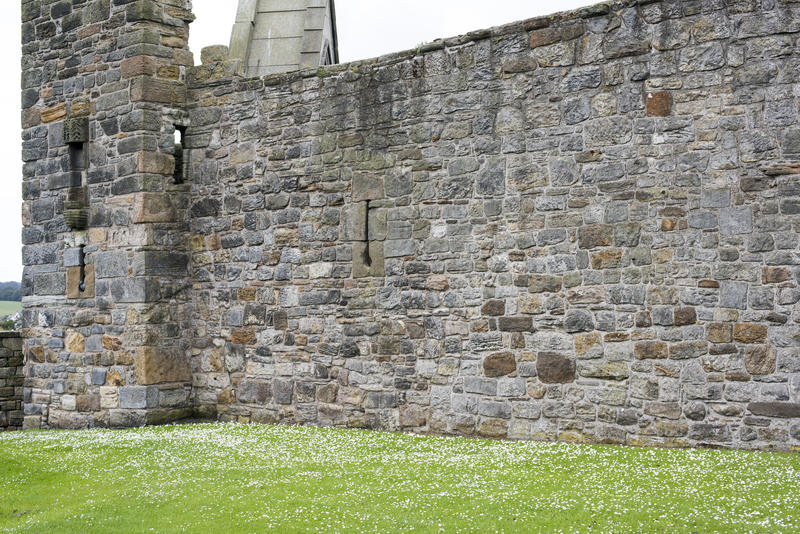 Fortified stone block wall at Saint Andrews Cathedral in Scotland, Europe. Includes copy space.