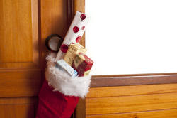 13152   Red Christmas stocking filled with small gifts