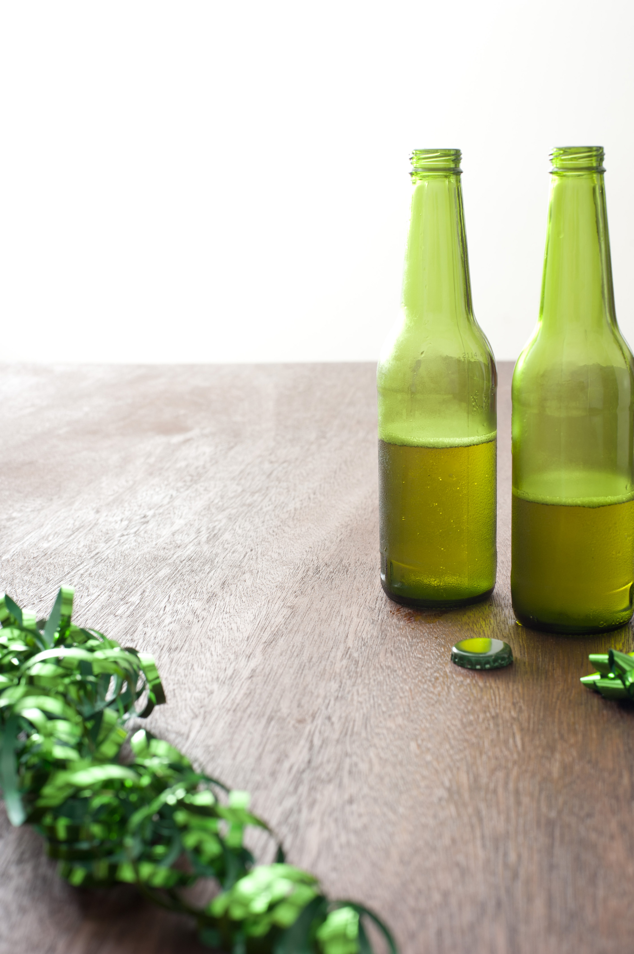 Free stock photo 12097 green ribbons and bottles of beer for Beer bottle picture frame
