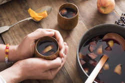 17170   Person warming their hands on mulled wine