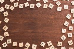 13086   Frame composed of wooden alphabet letter blocks