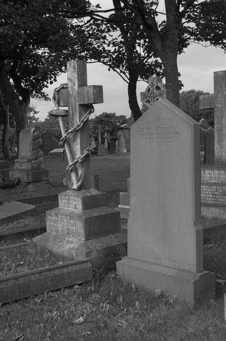 <p>Black and white photo of gravestones. Layton cemetery is a graveyard located at Talbot Road in Blackpool, Lancashire in England.</p>