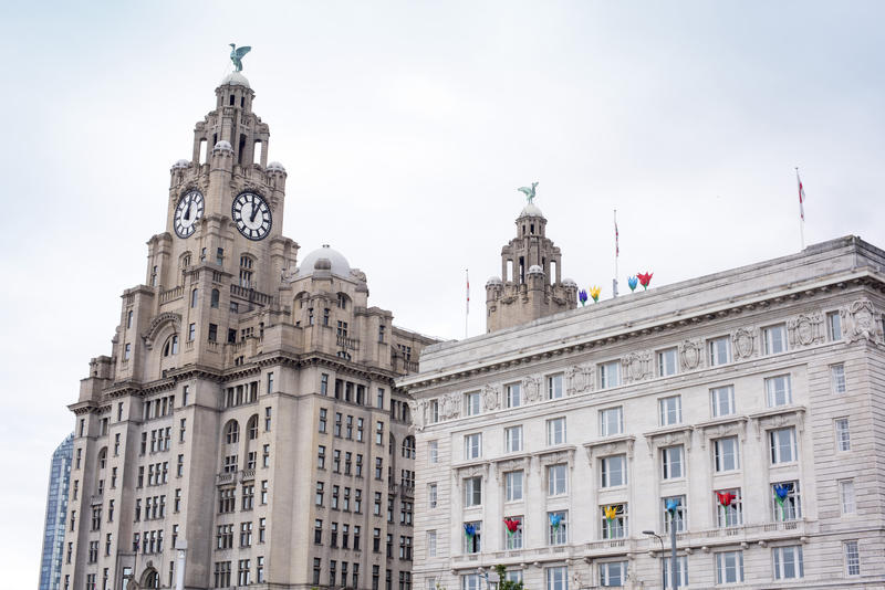 View on top section of the Liver building and clock tower in downtown Liverpool, United Kingdom