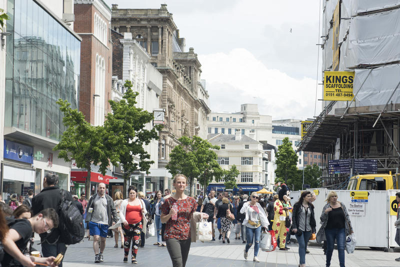 Street scene in Liverpool, UK with crowds of shoppers and pedestrians in a commercial district