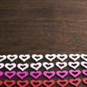 13105   Four lines of colorfully shaped hearts over wood