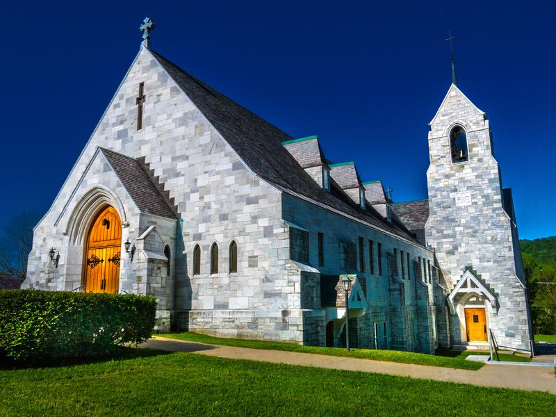 <p>North side of marble stone Catholic Church in rural Vermont early morning.</p>