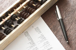 12720   Abacus with balance sheets and pen