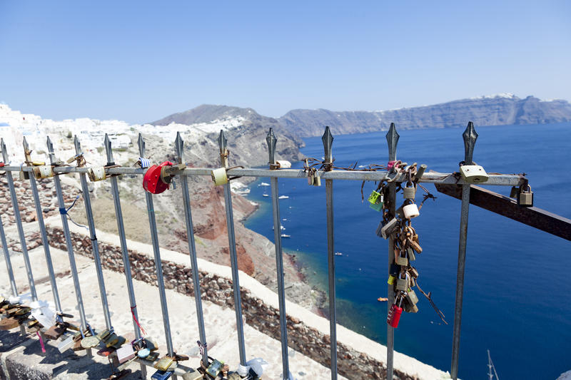 <p>Locked padlocks in Oia in Santorini have been left by couples as a symbol of love. Santorini is often known as the &#39;honeymoon island&#39; due to its popularity as a wedding and honeymoon venue.</p>