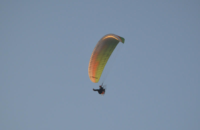 <p>Paragliding in the sky over Lancashire. Photographed at the beach in Cleveleys near to Blackpool</p>