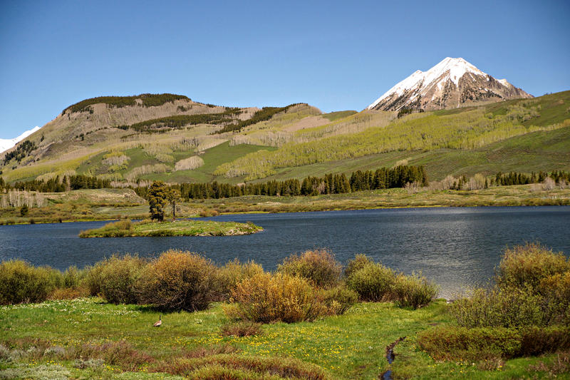 <p>Peanut Lake is a small body of water near Crested Butte Colorado.&nbsp;&nbsp; Here a small island can be seen in the middle of the lake.</p>