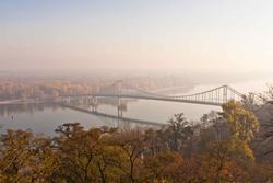 12049   pedestrian bridge on dnipro river in kiev in hazy autumn morning 1
