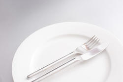 17161   Clean white plate with knife and fork
