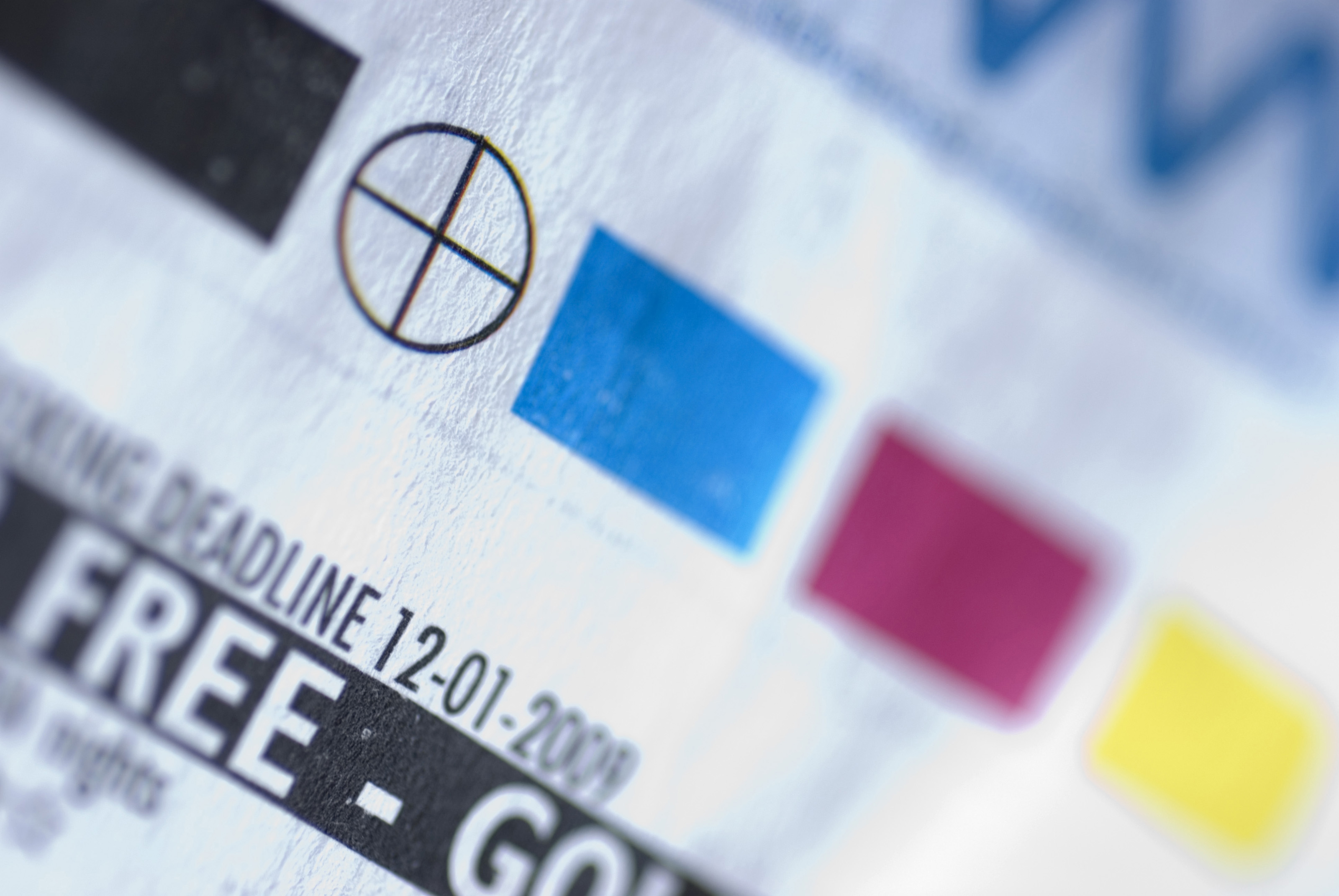 Selective Focus Extreme Close Up On Printer Registration Mark And Color Swatches Paper