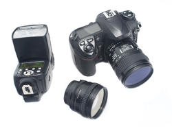 12191   Digital camera, lens and flash strobe
