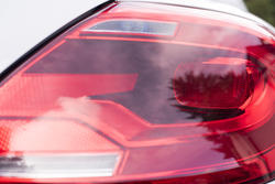 16358   Red lens of a rear light on a car
