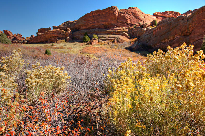 <p>Bright afternoon Colorado sunshine lights up Red Rocks Park as seen from the Trading Post Trail at Red Rocks Park and Amphitheater, Morrison Colorado.</p>