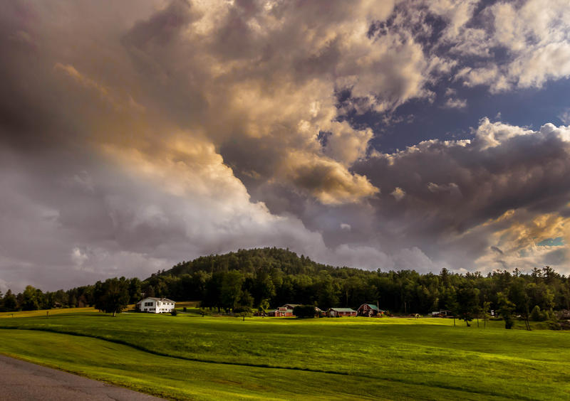 <p>Threatening storm clouds on the meadows in rural Vermont.</p>