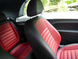 16360   Colorful red and black leather sports seats