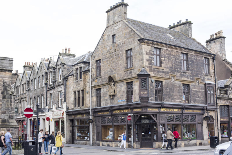 Corner store and intersection used by various tourists walking around and shopping in Saint Andrews, Scotland