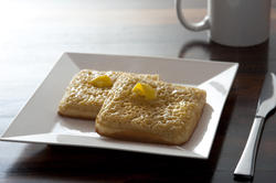 12278   buttered crumpets in square plate by knife