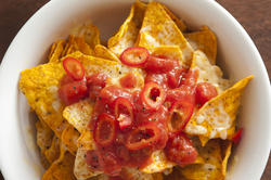 12774   tortilla chips covered in peppers