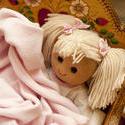 11979   Doll Nestled Under Blankets in Wooden Cradle